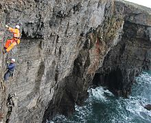 Geological survey of 100m high sea cliff
