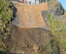 Caostal slope stabilisation using erosion control matting & rock netting