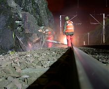 Rock drilling with air leg on rail cutting