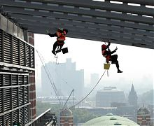 Painting of high level roof steelwork - London
