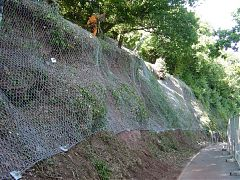 Rock fall netting and anchors to slope